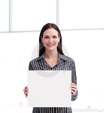 Smiling woman showing a big business card