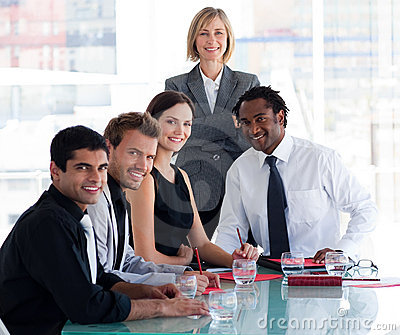 Business team smiling at the camera in office