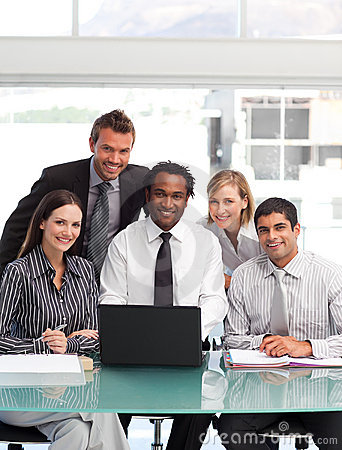 Business team working and smiling at the camera