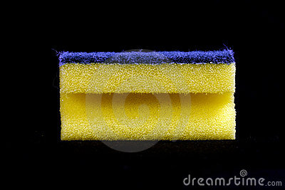 Yellow cleaning sponge black background