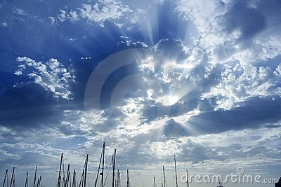 Cloudy sunset sky with sailboat mast