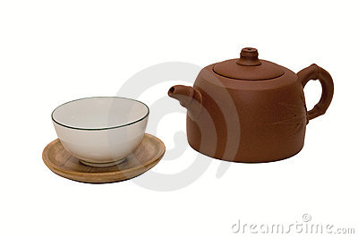 Close-up photo of brown teapot with teacup