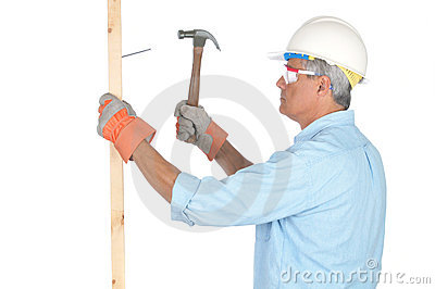 Middle aged Construction Worker With Hammer