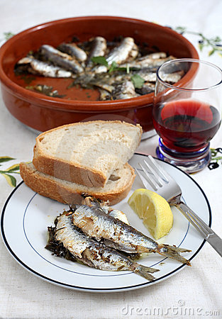 Sardines baked in a terracotta bowl