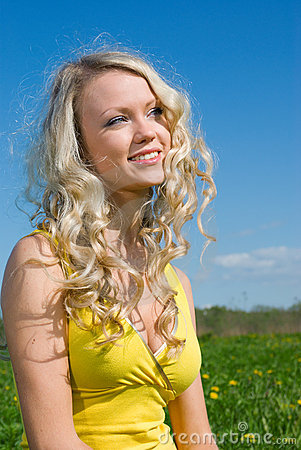 Sexy  blonde   on background of green meadow