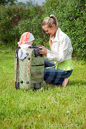 Girl and child in valise.family  to journey