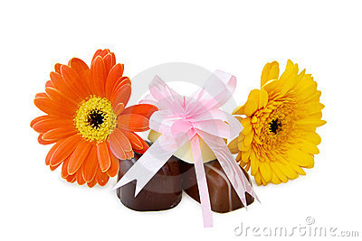 Chocolates and flowers over white