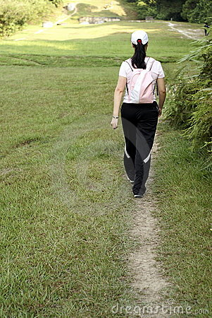 Asian lady hiking outdoors