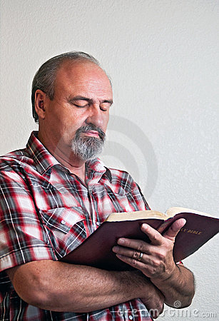 Adult male reading the Bible
