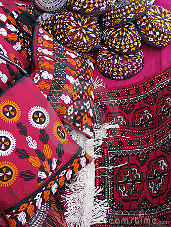 Oriental bazaar objects - bags, rugs and skull-cap