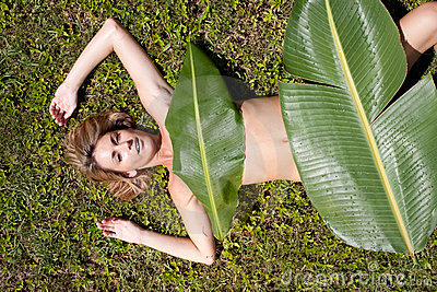 Woman in banana leaves
