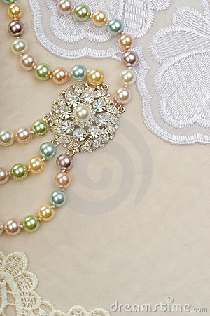 Necklace with brooch on lace background