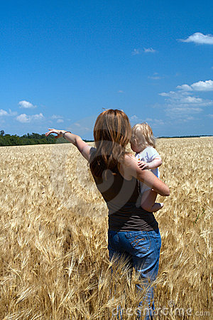 Mother with child at the wheat field