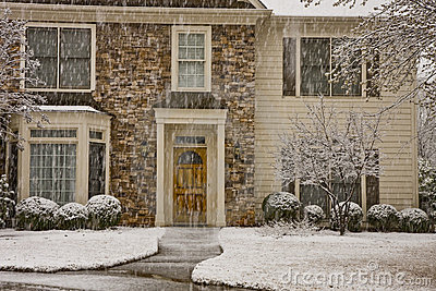 Snow Shower on Stone and Siding House