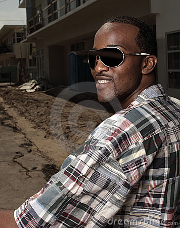 Image of a male smiling with sunglasses