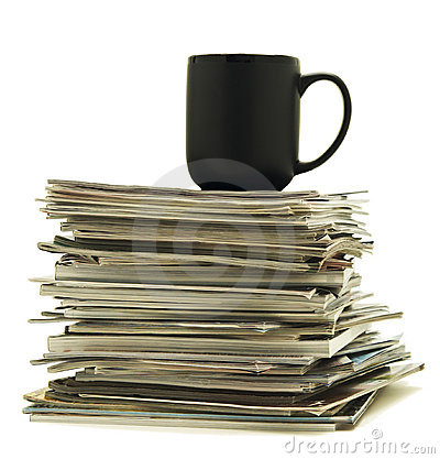 Mug on top of magazine stack