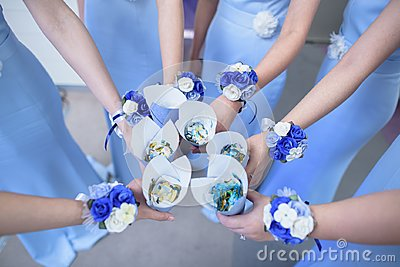Bridesmaid with flowers wrist corsage