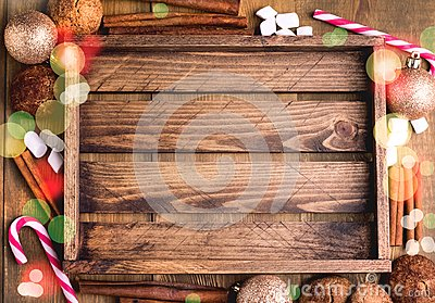 Cristmas background with place for text Topp view Wooden background Wooden tray Cookies Candy cane Cinnamon sticks Christmas card