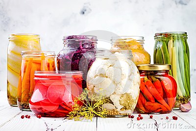 Sauerkraut and marinated pickles variety preserving jars. Homemade red cabbage beetroot, turmeric kraut,