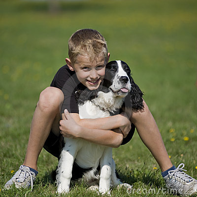 A boy poses with his puppy