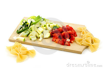 Pasta ingredients on wooden cutting board