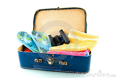 Suitcase with sandals, field-glasses and towels