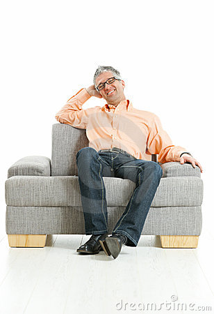 Relaxed man sitting on couch
