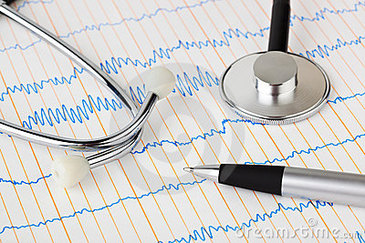 Stethoscope and pen on ecg