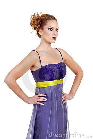 Woman wearing a purple dress with hands on her hip