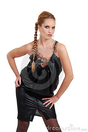 Woman with braided hair and black dress posing