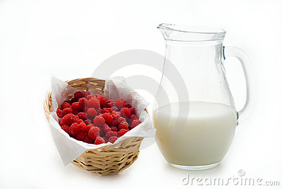 Raspberry and jug with milk