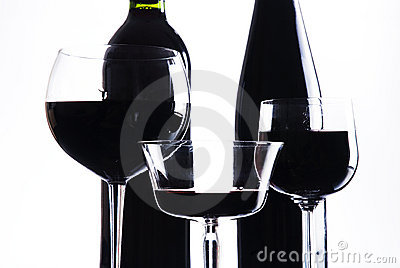 Three glasses with red wine and bottle