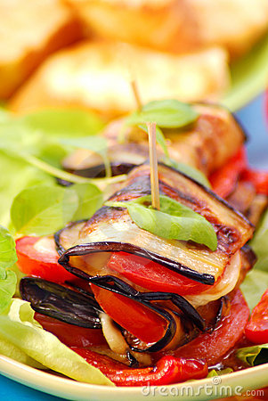 Grilled aubergine with cheese,paprika and tomato