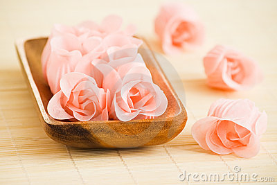 Rose flowers in wood tray