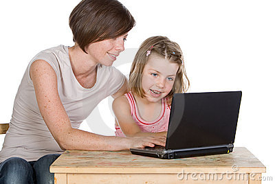 Mother and Daughter Using their Laptop
