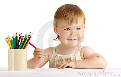 Happy child draw with red crayon