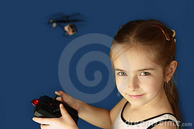 Girl playing with helicopter toy