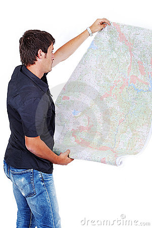 Man standing and looking at maps