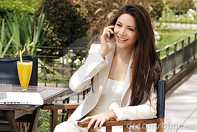 Beautiful young Business woman with movil