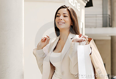 Beautiful young girl with a shopping Bag