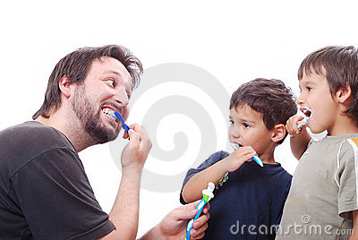 Father teaching his two sons how to clean the teet