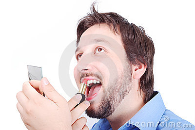 Man putting make-up on his lip