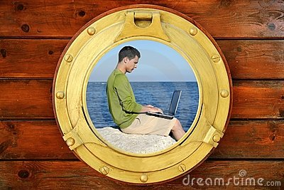 Businessman with computer, boat window view