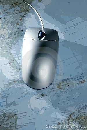 Computer silver wired mouse over blue  map