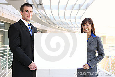 Business Team Holding Sign