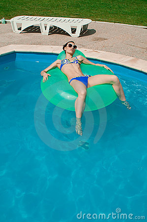 Woman in Inflatable ring in pool