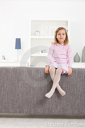 Girl in pink sitting on couch