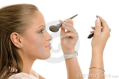 Woman doing makeup