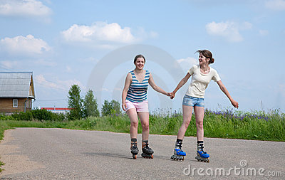 Two Young girls on roller blades