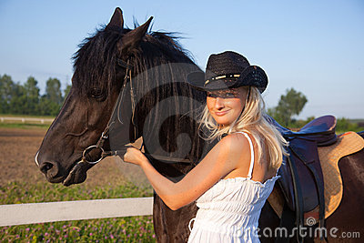 Young blond woman with horse